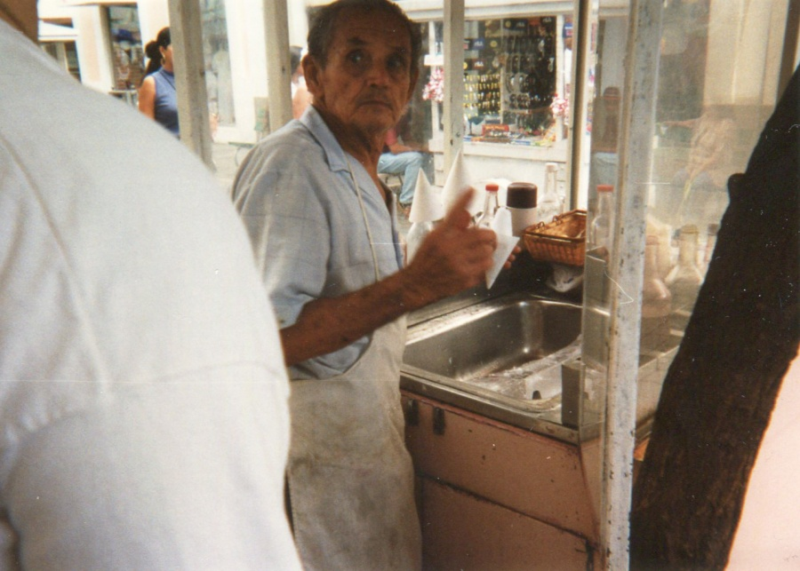 Snow cone vendor in Ponce. Notice the large block of ice to the right. He was chopping the ice by hand!
